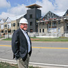 James Neiss/staff photographerNiagara Falls, NY - Gary Sankes, president and treasurer of Scrufari Construction Company, Inc., stands in front of the Niagara University B. Thomas Golisano Center for Integrated Sciences being built by his company.