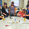James Neiss/staff photographerLewiston, NY - Instructor Amy Benjamin, a grad student in the NU math, science and technology program, shows students how to make organic sunscreen. Niagara University's Institute of Applied Learning, an arm of its College of Education, hosted STEM (Science, Technology, Engineering and Math) Camp for girls in grades 7-9. From left are, Sophie Mielnicki of Kenmore, Caitlyn Conibear of Lewiston, Instructor Samantha Love, Instructor Amy Benjamin and Kimberly Wilson of Lewiston.