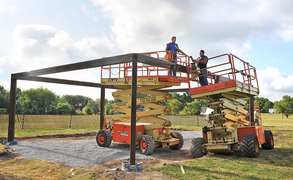 James Neiss/staff photographerNiagara Falls, NY - Niagara Falls Skilled Trades workers Kenny Redell, left and Dave Reppenhagen secure a steel beam on a pavillion being built at Gill Creek Park.