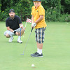 (second photo slugged 120731 Hyde Park Golf )James Neiss/staff photographerNiagara Falls, NY -  Vito Wojick, 8, practice putts at the Hyde Park Golf Course before a game there with his father Bruce. The two said they enjoy playing together and Vito is working on his game before the 35th Annual City of Niagara Falls Junior Golf Tournament for boys and girls ages 7-17 on Tuesday, August 14, at Hyde Park.