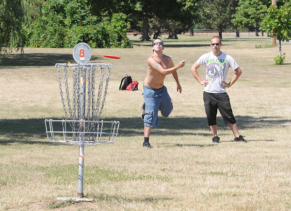 James Neiss/staff photographerLewiston, NY - Disk Golfers Rob D'Anna of Niagara Falls, left, and Brian Foy of Grand Island play the number 8 basket on a pleasant summer morning at the Joseph Davis State Park course.