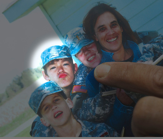 120828 Court Appearance 2James Neiss/staff photographerNiagara Falls, NY - Christopher DiDonna show reporters photos of a playful 13 year old John Freeman, second from left, when they were both involved in Niagara Falls Junior Military League Cadets.