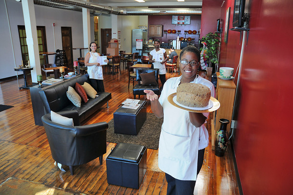 James Neiss/staff photographerNiagara Falls, NY - Staff at Yvonnes Bakery and Cafe, from left, Marissa Martell, Kamishia Prather and Owner Lakea Strong show off the spacious interior of the new 3rd Street restaurant including a delicious German Chocolate Cake.