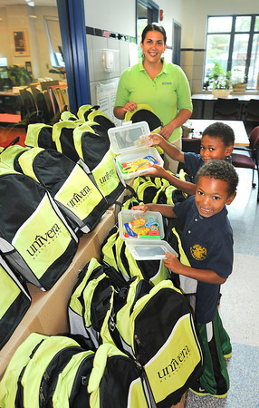 James Neiss/staff photographerNiagara Falls, NY - Tyquan Lewis, 7, and Kaden Quiros - Lewis, 6, were all smiles after Univera Healthcare Community Affairs Director Olivia Belter stopped by the Niagara Street Elementary School to donate 150 backpacks filled with school supplies, as part of Univera's Start Smart program.