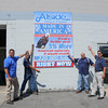 James Neiss/staff photographerNiagara Falls, NY - Employees at the Alside Supply Center , including from left, Pat Stoness, warehouse foreman, Ron York, operations manager, Brian Spence, supply center manager and John Tobia, district general manager, show their patriotism by asking people to buy American with this sign in front of their 6000 Packard Road business.
