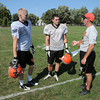James Neiss/staff photographerWilson NY - Wilson football players Taylor Thilk and Justin Slango meet with their coach Bill Atlas during practice.
