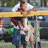 James Neiss/staff photographerNiagara Falls, NY - Alvin King Jr., 5, looks at a fly ball with awe as he watches the city championship little league baseball game with his father Alvin King at Nicoletti Field. The MacLeod's Pharmacy Braves beat the Tops Tigers for the title.