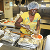 James Neiss/staff photographerNiagara Falls, NY - Volunteer Veronica Myles dishes out meals provided by the Niagara County Office for the Aging to seniors at the St. John's AME Church on Garden Avenue.  There is concern that the nutrition program there will end.