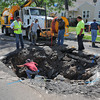 James Neiss/staff photographerNiagara Falls, NY - Crews from the Niagara Falls DPW, Water Board and Sewer departments try to figure out why a sinkhole keeps forming in the 3500 block of Ferry Avenue. Workers closed the street from Hyde Park Boulevard to address the problem.