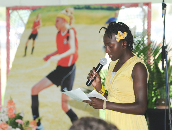 James Neiss/staff photographerWilson, NY - Zipporah Barrett says a few words about her best friend Sarah Johnson, background poster, during a Service of Healing and Remembrance at the Wilson Soccer Complex.