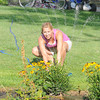 James Neiss/staff photographerNiagara Falls, NY - Stephanie Marazzo adjusts the sprinkler at her Rankine Road home. The dry summer weather is making watering plants a daily routine for many.