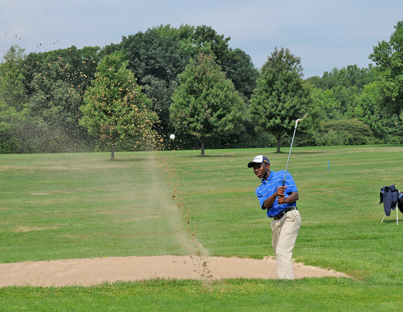 James Neiss/staff photographerNiagara Falls, NY - Jeremiah Gamble, 16, hits his ball out of a sand trap during the 35th Annual City of Niagara Falls Junior Golf Tournament at Hyde Park. Officials, said that the tournament was a big hit with about double the participants this year.