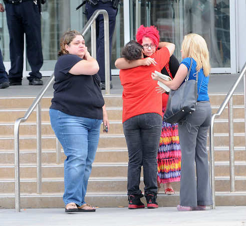 James Neiss/staff photographerNiagara Falls, NY - Brandy Reid, left, who, said she is best friends with Tyler Best's mother, gathered with friends who were comforting each other after accused murderer John Freeman and Tyler Best, charged with evidence tampering, were arraigned in City Court for the death of 5-year-old Isabella Tennant.