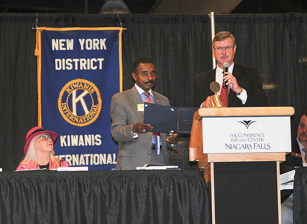 James Neiss/staff photographerNiagara Falls, NY - Mayor Paul Dyster proclaims Friday August 17, as Kiwanis Day in Niagara Falls, right, as New York District Kiwanis Governor William F. Risbrook accepts the proclamation. Featured speaker Past Governor Janet Flinders of the Utah-Idaho District sits at left.  The New York District Kiwanis International 95th Annual District Convention is underway at the Conference Center Niagara Falls. The organization is also celebrating 25 years of women in Kiwanis this year.