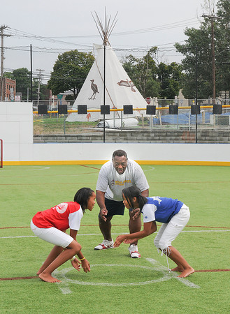 "James Neiss/staff photographerNiagara Falls, NY - Master Charles Bray, with the Sumo Kids Foundation, referees a Sumo practice session between sisters Kasha Spencer, 12, left, and Tracy, 14. The Sumo Kids Foundation is hosting the ""World's Biggest Children's Sumo Festival"" at the Smokin Joes Arena on First Avenue, August 21, at 11 a.m."