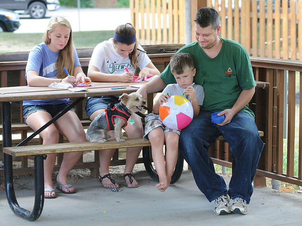 James Neiss/staff photographerYoungstown, NY - Crafters, from left, Karalyn Oddy, 15, Emily Muller, 16, Kong the Dog, Zachary Liger, 4, and his uncle Scott Liger, color beach balls during Arts & Crafts, part of the Youngstown Recreation Falkner Park Children's Summer Program. This Saturday, August 11, Youngstown is have a Community Picnic there with fun and activities for all.
