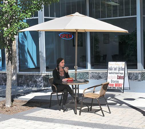 James Neiss/staff photographerNiagara Falls, NY - Alexandria Paretto, 23 of Niagara Falls, enjoys an Iced Coffee and a Chicken Salad Sandwich Combo at Yvonnes Bakery and Cafe on 3rd Street.