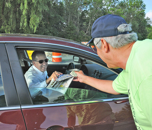 James Neiss/staff photographerNiagara Falls, NY -  Scott Jones with United Steel workers 9434 sells a Make a Difference Day Niagara Gazette newspaper to Tom Acara on his way to work at The Conference & Event Center Niagara Falls on Niagara Falls Boulevard at Walmore Road. Proceeds to benefit the United Way of Greater Niagara and United Way of the Tonawanda's.