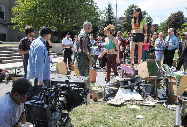 James Neiss/staff photographerNiagara Falls, NY - Cast and crew of Return To The Class Of Nuke'Em High, directed by Lloyd Kaufman, left, practice a scene on the front lawn of the Niagara Arts and Cultural Center.