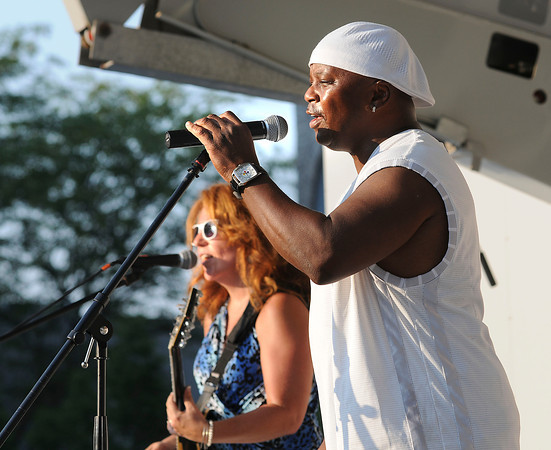 James Neiss/staff photographerNiagara Falls, NY - Members of the band White Chocolate play for the crowd on Old Falls Street Friday night, as part of the summer concert series there.