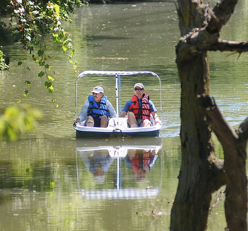 James Neiss/staff photographerNiagara Falls, NY - PEDAL POWER: John Bankowski of Niagara Falls, left, took his brother Jim, from Buffalo, out for a ride in his paddle boat on Cayuga Creek. The two got plenty of exercise paddling the boat, said John.