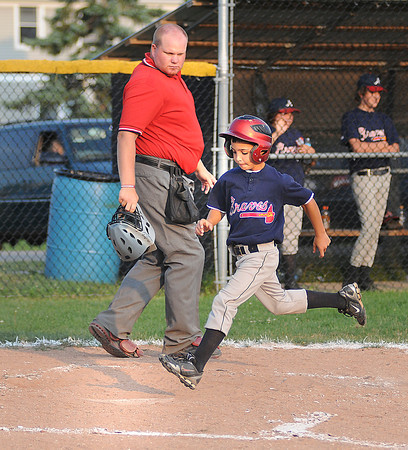 James Neiss/staff photographerNiagara Falls, NY - The MacLeod's Pharmacy Braves #3 Derek Soluri brings in a run during the 5th inning of baseball game action against the Tops Tigers in the city championship game.
