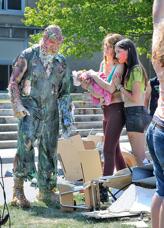James Neiss/staff photographerNiagara Falls, NY - Cast members of Return To The Class Of Nuke'Em High, from left, Josh Potter as the Duck Monster, Katie Corcoran and Asta Paredes film a scene on the front lawn of the Niagara Arts and Cultural Center.
