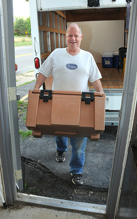 James Neiss/staff photographerNiagara Falls, NY - Dave Doyle a driver with the Niagara County Office for the Aging delivers meals to the St. John's AME Church on Garden Avenue.  There is concern that the nutrition program there will end.
