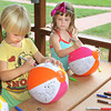 James Neiss/staff photographerYoungstown, NY - Lillian Howard, 4, left and Lauren Fura color beach balls during Arts & Crafts, part of the Youngstown Recreation Falkner Park Children's Summer Program. This Saturday, August 11, Youngstown is have a Community Picnic there with fun and activities for all.