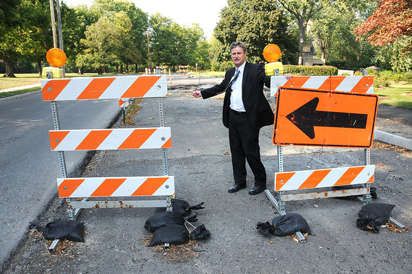 James Neiss/staff photographerNiagara Falls, NY - Mayor Paul Dyster, said that after residence tipped off the city, police ordered Man-O-Trees workers to replace barriers and signs they were removing from around road hazards on Lewiston Road. Dyster, said the removal of the barriers and signs would create a danger to the general public, especially on a holiday weekend.