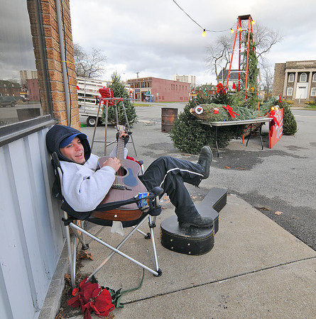 James Neiss/staff photographerNiagara Falls, NY - Customers stopping to buy a Christmas tree may be serenaded by musician Scott MacCallum, who was seen singing a Christmas Carol at his tree stand on Main Street  and Park Place, across the street from the Niagara Falls Post Office. MacCallum, said the trees are selling from between $40-$80 with part of the proceeds benefiting Opportunities Unlimited.
