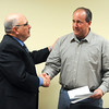 James Neiss/staff photographerNiagara Falls, NY - Roger Trevino, a partner of Niagara Falls Redevelopment, LLC., presented Niagara Falls Police Officer Bill Gee who to help him with his finances as he fights a battle with stomach cancer.