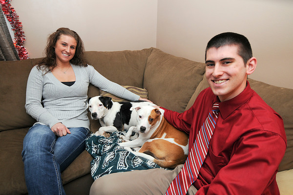 James Neiss/staff photographerGrand Island, NY - Kate and Dan Ritch are members of Silverlining for Pitbulls and rescued their two dogs Tallie and Zoe.