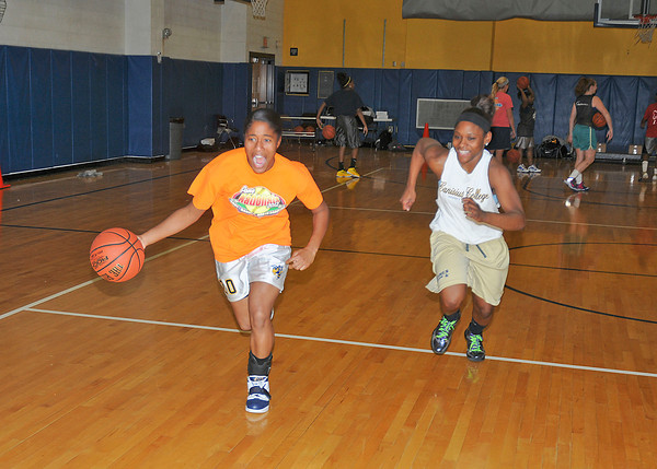 James Neiss/staff photographerNiagara Falls, NY - Niagara Falls girls basketball players Toni Polk, left and Victoria Pryor practice at the high school.