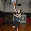James Neiss/staff photographerNiagara Falls, NY - Niagara Wheatfield boys basketball player Jack Mulcahy puts the ball up during practice.