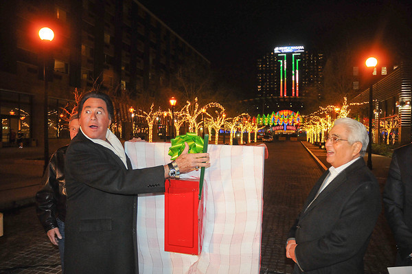 James Neiss/staff photographerNiagara Falls, NY -  Mr. Las Vegas Wayne Newton turns on the lights on Old Falls Street after receiving the key to the city. Newton is in town to perform several holiday shows at the Seneca Niagara Casino and Hotel. Seneca Nation President Barry Snyder Sr., right, joined him in the festivities.