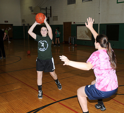 James Neiss/staff photographerLewiston, NY - Emily Muler looks to pass during practice drills.