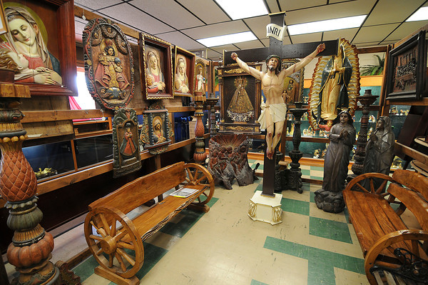 James Neiss/staff photographerNiagara Falls, NY - Our Lady of Fatima Director Father Julio Ciavaglia has a love for art and sells works from around the world at the shrine's gift shop.