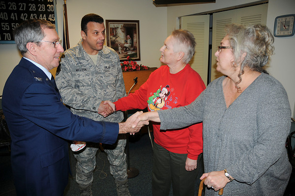 James Neiss/staff photographerNiagara Falls, NY - Retired Colonel Jim Germain, left, and Michael Melson, both with the 914th Airlift Wing, accept a donation from residents of Wheatfield Towers Senior Housing, represented by Pam Stone and Lori Raymond. The residents raised $425 that will benefit a reservist with 5 children, whose wife was recently diagnosed with MS.