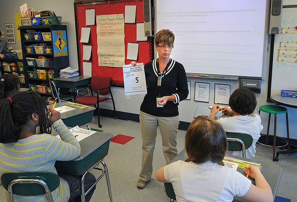 James Neiss/staff photographerNiagara Falls -  Niagara Street Elementary 5th grade teacher Sandra Peters shows a sample State test that her students used to practice with.