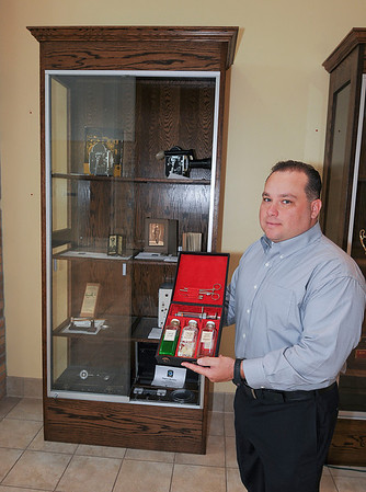 James Neiss/staff photographerNiagara Falls, NY - Niagara Falls Police Lt. Bryan DalPorto shows off a Post Mortem Finger Print Kit used by the Niagara Falls Police between the 1940 and 1980 that is currently on display in the lobby of the Niagara Falls Public Safety Building.