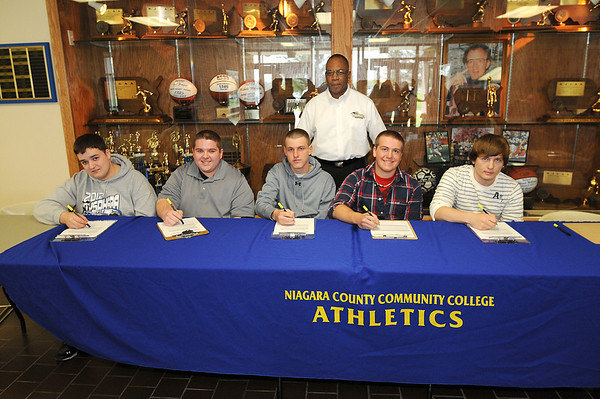 James Neiss/staff photographerNiagara Falls, NY - Niagara County Community College signs local high school students to their Men's Bowling program. From left are, Tyler Laubacker of Lockport, Eric Michalski of Amherst, Tom Iacono of North Tonawanda, Coach Anthony Massop, Shane Ryan of Silver Creek and Bradley Bender of Tonawanda.