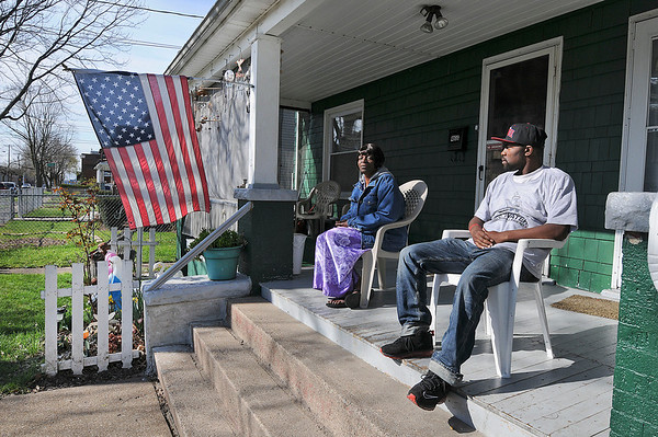 James Neiss/staff photographerNiagara Falls, NY - Neighbors Joan Jones and Demetrius Gregory start the day with conversation and warming themselves in the bright morning sun on the porch at their 24th street duplex.