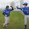 James Neiss/staff photographerSanborn, NY - Grand Island #9 John McGinty is greeted by teammate #2 Jon Voyzey after hitting a triple that brought in two runs in the 2nd inning during baseball game action against Niagara Wheatfield.