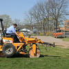 James Neiss/staff photographerNiagara Falls, NY - Operating Engineers David Robertson, left, and Fran Bue roll a baseball diamond at Hyde Park in preparation for the 2012 little league season.