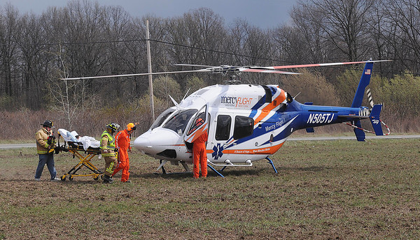 James Neiss/staff photographerNiagara Falls, NY - Lewiston #2 and Mercy Flight personnel carry a young burn victim to a waiting helicopter that landed in a field at the corner of Walmore and Upper Mountain Roads for transport to Childrens Hospital.