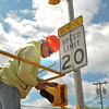 James Neiss/staff photographerNiagara Falls, NY - Signal Technician Russell Zemke with South Buffalo Electric, installs school warning beacons in the 7600 block of Buffalo Avenue , one of two now near the LaSalle Preparatory School. Zemke, said the signals will be operational once power is run to them at a later date.