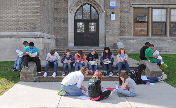 James Neiss/staff photographerNiagara Falls  - Students take advantage of the warm Friday weather to study for their Spanish final exam outside the Gaskill Preparatory School.