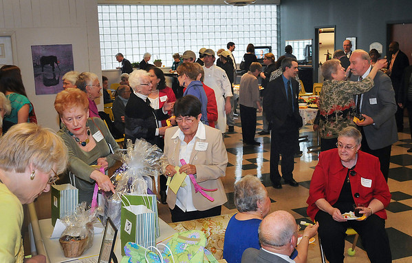 James Neiss/staff photographerNiagara Falls, NY - Guests enjoy good conversation, drinks, snacks and placing tickets in basket auctions before dinner at the Heart Love and Soul 30th Anniversary Celebration.