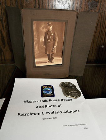 James Neiss/staff photographerNiagara Falls, NY -  Niagara Falls Police Lt. Bryan DalPorto shows off some of the police artifacts he is organizing for display in the lobby of the Niagara Falls Public Safety Building. Already on display is a photo and badge of Patrolman Cleveland Adamec.